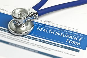 Health insurance form with a stethoscope