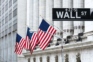 New York Stock Exchange with the Wall St street sign in front
