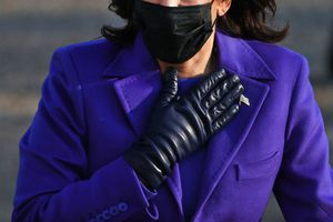 Vice President Kamala Harris with a black mask on, hand over her heart