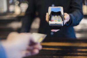 Man Using Credit Card Reader