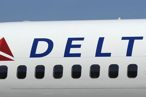 A Boeing 757 with a new Delta Airlines logo.