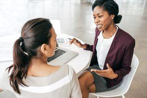 Business women talking in the office.