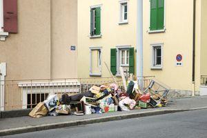 Belongings piled on sidewalk outside building