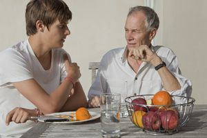 Older father talking with teen