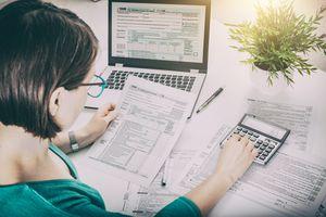 Woman doing taxes at computer