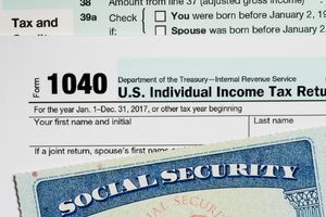 A social security card laid on top of Form 1040 tax return.