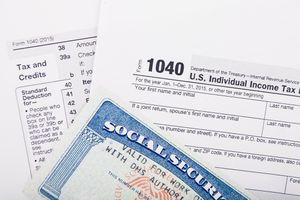 U.S. individual income tax return form and Social Security number card.