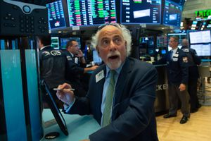 Traders work on the floor at the closing bell of the Dow Industrial Average at the New York Stock Exchange
