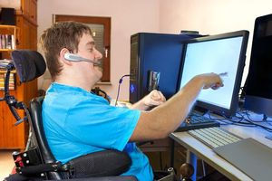 Man with disabilities at computer