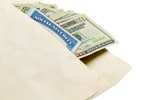 A social security card and twenty dollar bills in envelope against white background.