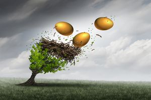 Golden (nest) eggs flying out of a nest in a storm