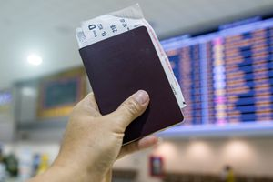 Passport and Boarding Pass Looks at the Airport Departure