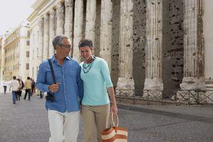 Couple walking in Piazza di Pietra, Italy