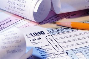 Tax Forms, Pencil and Receipts