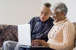 Senior African American couple at laptop