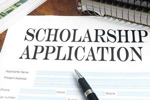 Scholarship application on table with pen