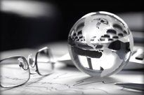 Glasses and glass sphere on table