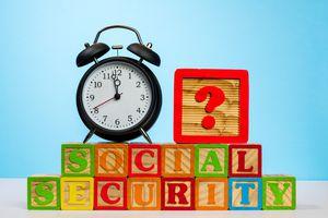 An alarm clock on wooden blocks for Social Security.