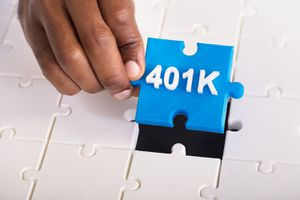 Hand Holding 401k Jigsaw Puzzle