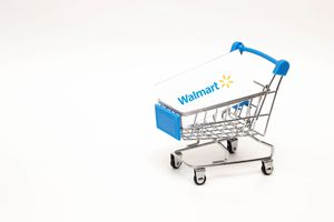 Shopping trolley with a Walmart card on a white background.
