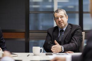 Businessman explaining positioning in meeting