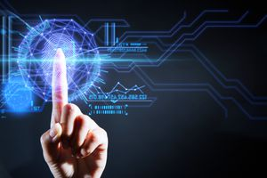 An index finger touching a security user interface technology and scanning the fingerprint.