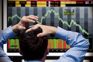 Stock trader watches stocks crash on screen