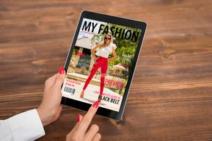 Woman Reading eMagazine on Tablet