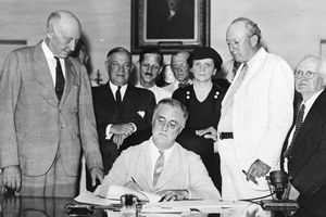 Franklin Delano Roosevelt signs the Social Security Act of 1935 into law -- 14 August 1935