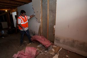 Basement with worker fixing mold damage