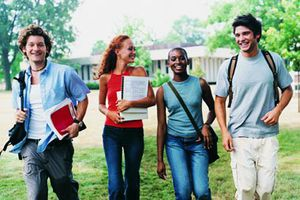 Four college students walking outdoors together