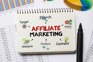 Notebook with tools and notes about affiliate marketing.