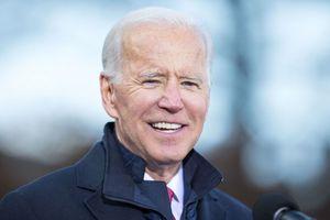Joe Biden Outdoors at Microphone in Blue Suit and Overcoat