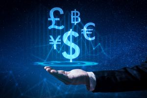 A business man hold the virtual hologram on hand with various foreign currencies.