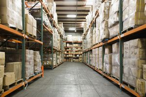 Warehouse with shelves stacked full of packing boxes