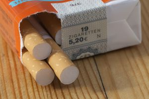 A pack of German cigarettes on a wooden table, close-up