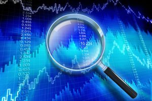 Financial data showing a rising trend with magnifying glass.