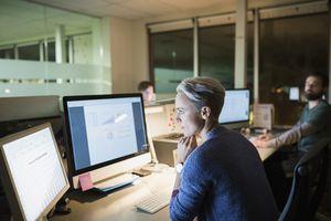 woman at desk looking at financial software