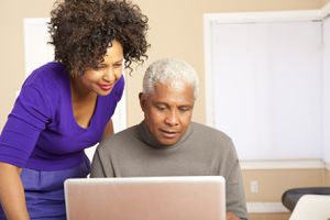 Older couple reading a laptop screen