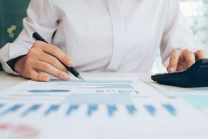 A businessman analyze investment marketing data.