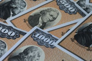 Close up of U.S. bonds in $500 and $1000 denominations