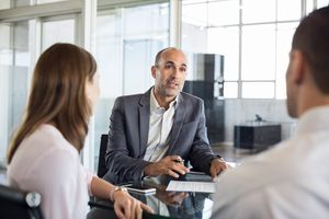 financial adviser speaking clients