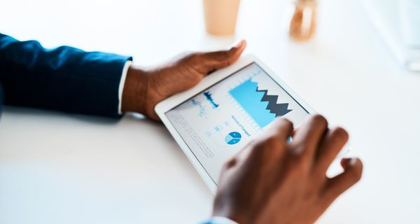 Investor reviews stock information on a tablet