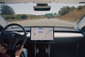 Tesla Autopilot engaged on a freeway.