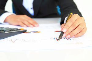 A financial advisor explaining investment charts.