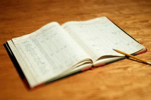 A ledger with a pencil on it