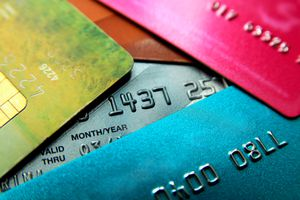 Stack of multicolored credit cards, close-up view with selective focus