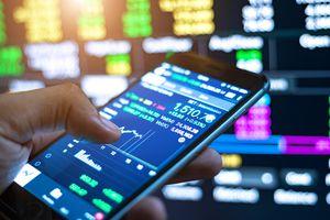 Man Checking Stock Market On Mobile Phone