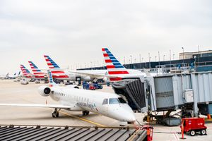 American Airlines planes finishing up for take-off at gate