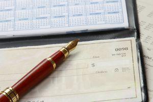 Checkbook with fountain pen